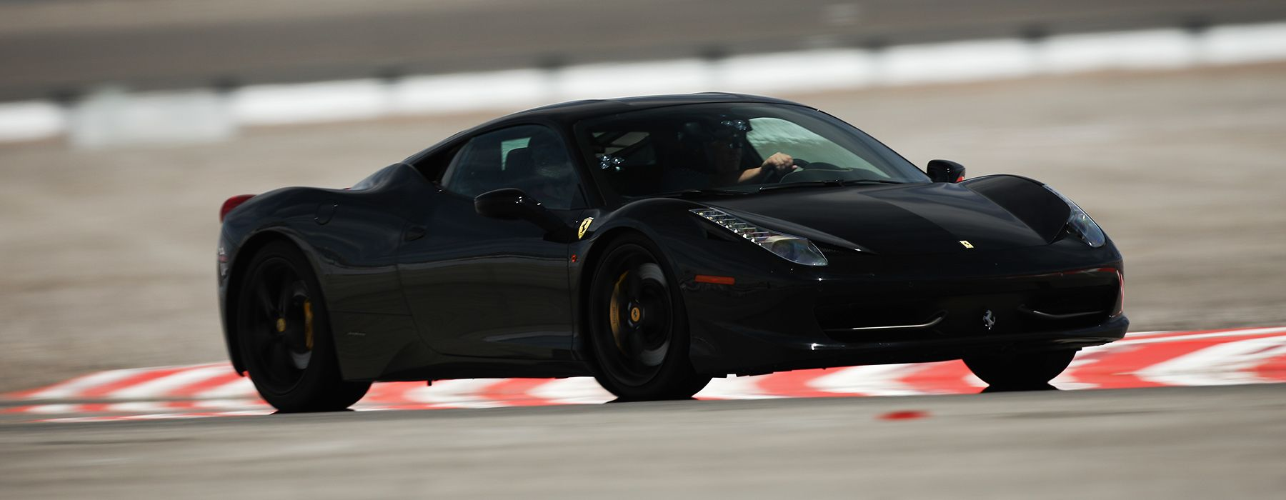 Drive a Ferrari Supercar on a Professional Racetrack with Exotics Racing